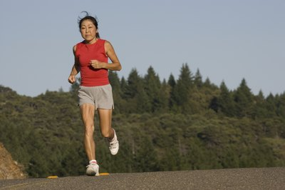 A woman jogging on a mountain road