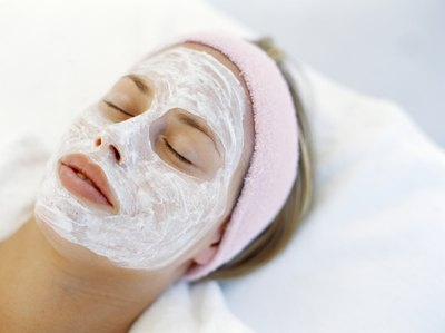 Woman with beauty mask treatment on skin