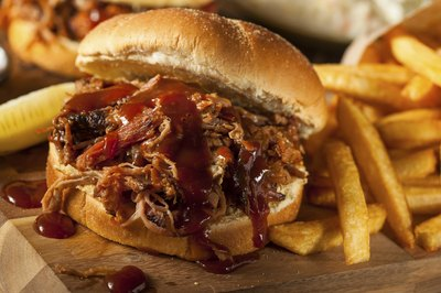 Pulled pork sandwich with barbecue sauce and french fries