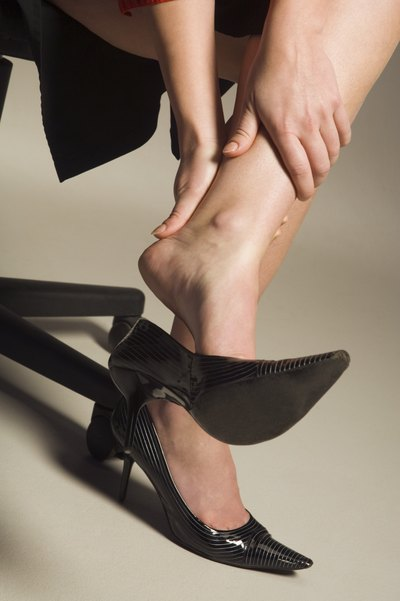 Woman rubbing her heel