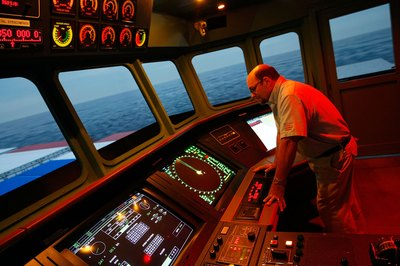 A merchant marine charts the course of the vessel.