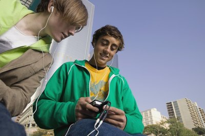 Teens using mp3 player