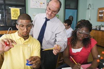 Teacher and students in laboratory classroom