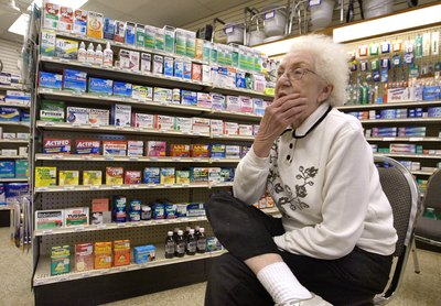 Woman waiting for her prescription at pharmacy