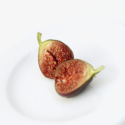 The cross-section of a fig on a plate.