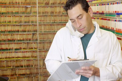 Medical billers and coders manage paperwork in medical offices.