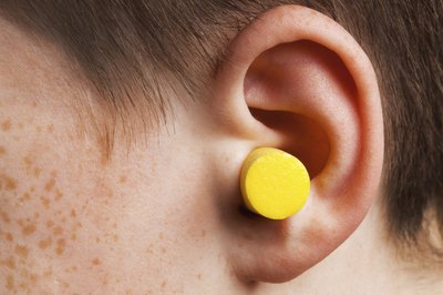 Wearing earplugs.