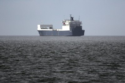 A cargo ship on the open water.