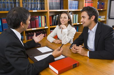 Woman meeting with lawyer