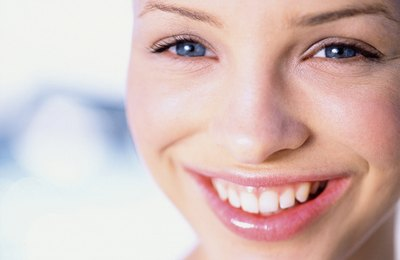 A close-up of a young woman smiling