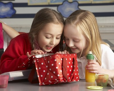 Children looking in insulated lunch box