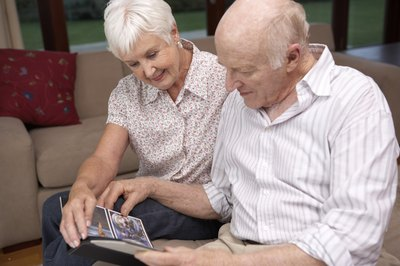 couple looking at photos from reunion