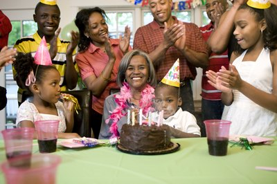 Family celebrating woman's grandmothers birthday
