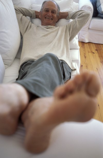elderly man with his feet up