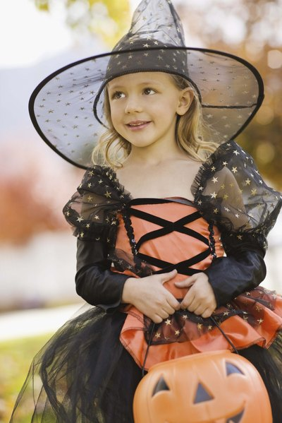 Pretty witches need only sparkly natural lip gloss and a magical costume.