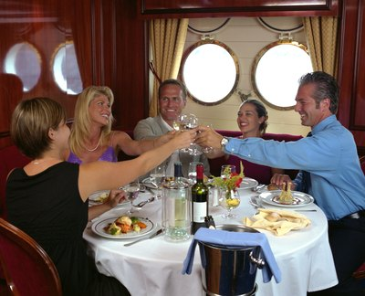 A group makes a toast at a restaurant on a cruise ship.