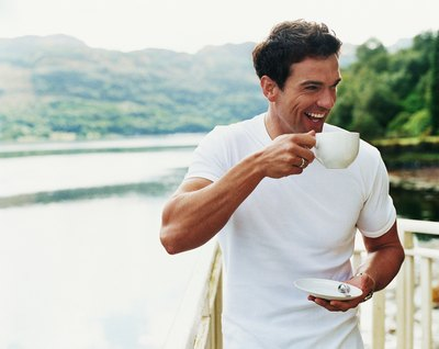Caffeine causes an increase of dopamine in the brain leading to feelings of happiness.