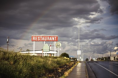 Large restaurant sign along highway