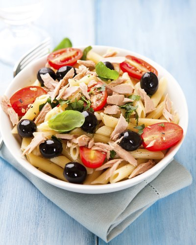 Pasta salad with olives, tuna and tomatoes
