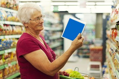 Mature woman reading a product label.