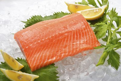 Salmon on ice with lemons and herbs.
