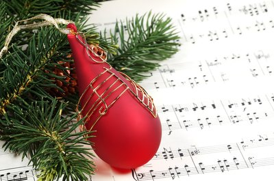 Choose Christmas carols to play for the group.