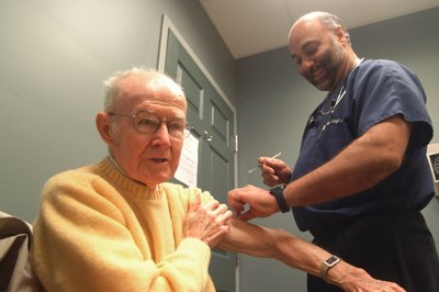 Man receives flu shot from Ft. Erie, Ontario