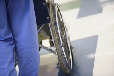 Hospital staff with wheelchair