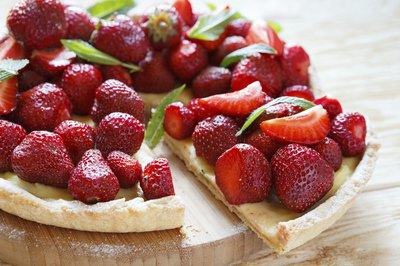 A tart made with fresh strawberries and mint.