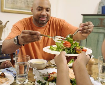 Father serving salad