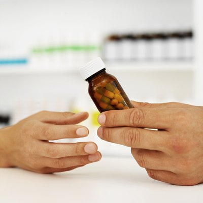 Some drugs, both prescribed medication and illegal drugs, can cause the side effect of shaking hands.
