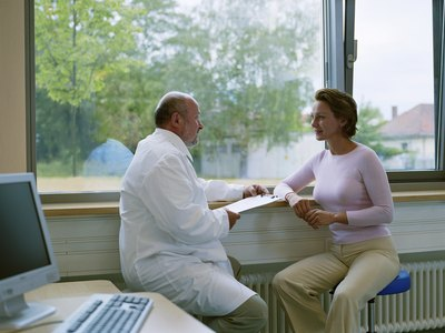 Doctor discussing test results with patient