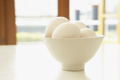 Small bowl filled with eggs.