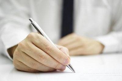 Man completing business forms
