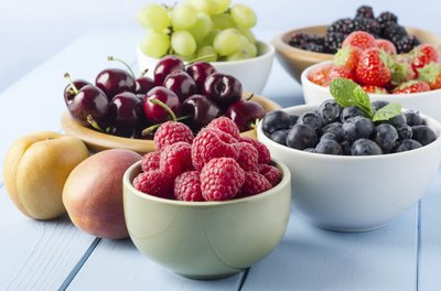Assorted bowls of summer fruits