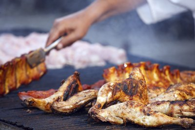 Chicken and meat on barbecue