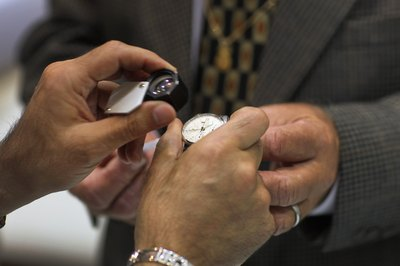 Rolex watch being examined