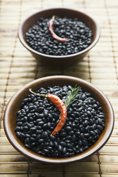 Bowl of black beans with chili pepper
