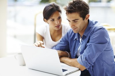 Couple working on business plan