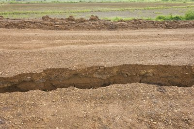 A large split in sandy soil from an earthquake.