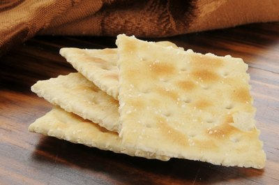 Saltine crackers on table.