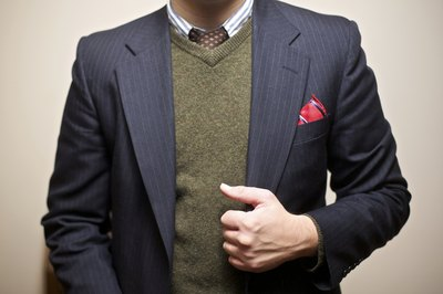 A thinly striped blazer can be paired with a pocket scarf or a patterned tie