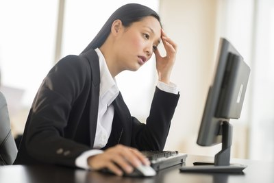 A woman feeling fatigue at work