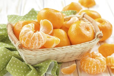 A small basket of tangerines.
