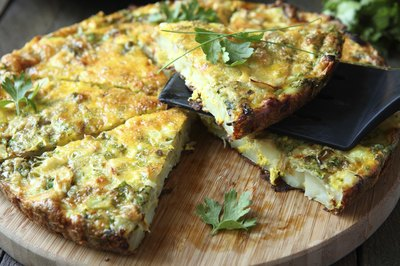 A frittata with fresh greens.
