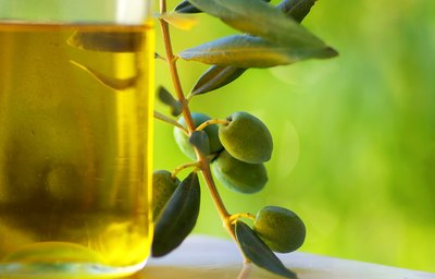 Close-up of olive oil in a glass bottle.