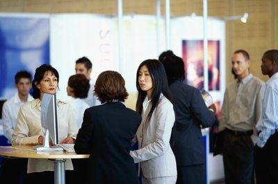 Businesspeople exchange information at a conference.