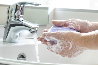 Close-up of hands being washed