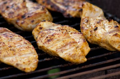 Chicken breasts on grill.