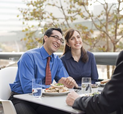 Offer a schedule change to a successful employee. He can get a day off, come in late, leave early or take a long lunch.